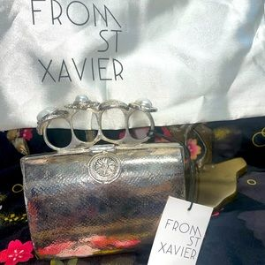 From st Xavier gemstone top ring metal small clutch brand new